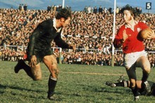 J.P.R Williams of the British Lions takes on New Zealand's Ian Kirkpatrick during a test match on the British Lions Tour to New Zealand in 1971. Photo / Getty Images