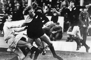 Bruce Robertson about to score one of the All Blacks' five tries against Combined Services during the UK Tour in 1978. Photo / NZ Herald Archives