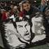 Fans hold up a picture of All Blacks captain Richie McCaw at Eden Park. Photo / Getty Images