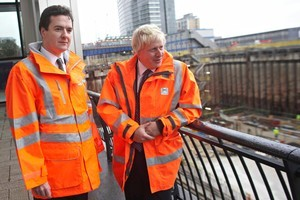 Britain's Chancellor George Osborne and London Mayor Boris Johnson look over the Crossrail site at London's Canary Wharf. Photo / Supplied