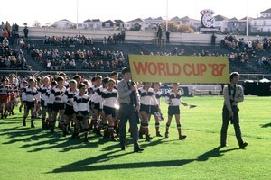 Sparse turnout: Scouts carry a banner during the 1987 Rugby World Cup opening ceremony at Eden Park. Photo / Getty Images