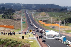 People walk and cycle on the new Hobsonville Motorway during its official opening. Photo / Herald on Sunday
