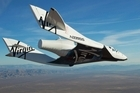 Virgin Galactic's SpaceShip2 glides over the Mojave Desert last year, in preparation for tourist flights to the edge of space. Picture / Virgin Galactic