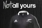 An altered adidas poster advertising the controversial adidas All Blacks rugby jersey on Karangahape Road. Photo / Dean Purcell.