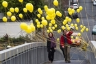 The woman who tethered the balloons to the Newton pedestrian bridge says she did it to cheer people up. Photo / Paul Estcourt