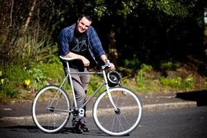 Justin Newcombe with his refurbished fixed wheel Avanti bike. Photo / Dean Purcell