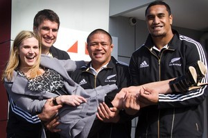 Actress Beth Allen with (from left) Anthony Boric, Keven Mealamu and Jerome Kaino during a break in filming. Photo / Paul Estcourt