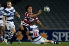 Counties Manukau's Tasesa Lavea is tackled by Auckland's Gareth Anscombe. Photo / Richard Robinson