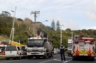 The scene on Normanby Road in the Auckland suburb of Mt Eden, where two workers were electrocuted when they backed into overhead powerlines. Photo / Richard Robinson.