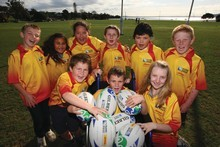 Some of the lucky ball-runners picked to deliver match balls before thousands of spectators. Photo / Jo Caird