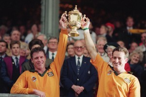 Nick Farr-Jones (left) and David Campese celebrate after Australia beat England 12-6 in the World Cup final at Twickenham in November 1991. Photo / Getty Images
