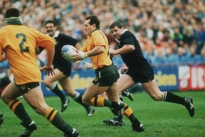 David Campese in full flow against the All Blacks during their semifinal clash at Lansdowne Road. Photo / Getty Images