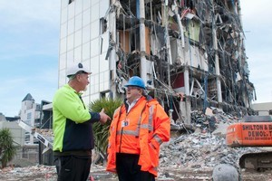 Jim Shilton of Shilton and Brown Demolition speaks with earthquake recovery minister Gerry Brownlee while on a tour of demolition work in the red zone, Christchurch, New Zealand, Friday, July 29, 2011. Photo/ NZPA