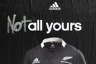 A rugby fan makes a  point in this defaced adidas poster on K Rd.  Photo / Dean Purcell