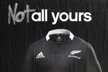 An adidas poster advertising the controversial Adidas All Blacks rugby jersey on Auckland's Karangahape Road has been recently defaced. Photo / Dean Purcell.