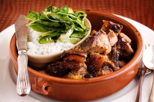 Caramalised pork belly with rice and greens. Photo / Babiche Martens