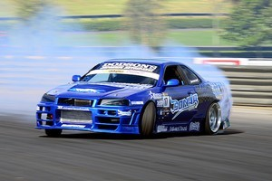 Kiwi drifters Curt Whittaker in action at the Tectaloy International Drift Challenge in Sydney. Photo / Fast Company Roo Wills.
