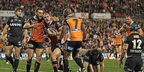 Gareth Ellis of the Tigers is scores a try. Photo / Getty Images