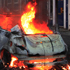 A car burns after it was set on fire by rioters in Hackney, east London. Photo / AP