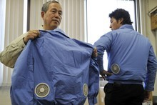 Japanese entrepreneur Hiroshi Ichigaya is selling jackets, shirts and pants outfitted with battery-powered 'personal cooling systems'. Photo / AFP