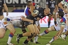 Sam Rapira of the Warriors fends off Ryan Stig of the Knights. Photo / Getty Images