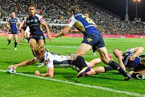 Jack Reed of the Broncos scores the second try of the match. Photo / Getty Images