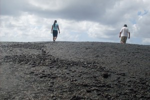 Walking across the Lava Fields left by the eruptions of Mt Matavanu between 1905 to 1911. Photo / Vaimoana Tapaleao