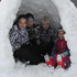 School kids, Amy Mead, Noah Franklin, Fynn Franklin and Sophie Mead who are off school for two days get creative and build a snow igloo in Arrowtown. Photo / Helene Franklin