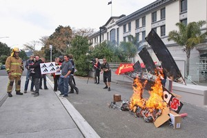 Protesters from Socialist Aotearoa make their anti-adidas feelings known. Photo / Getty Images