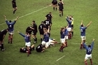 The French players celebrate as the All Blacks reel in shock at the loss. Photo / Allsport
