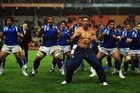 Brian Lima, leading the Samoan team's war dance, was called