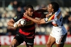 Patrick Oshorne of Canterbury fends off the tackle of Save Tokula of Waikato. Photo / Getty Images
