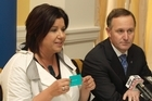 John Key with Social development Minister Paula Bennett holding the Government's new payment card. Photo / Mark Mitchell