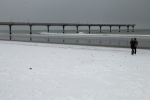 Snow has reached sea level at areas like Christchurch's New Brighton beach, and more is to come. Photo / Simon Baker