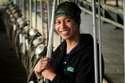 Jordana Thomas in the old milking shed on the dairy farm where she is doing work experience. Photo / Alan Gibson