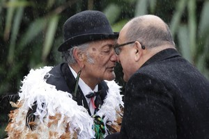 The Governor-General, Sir Anand Satyanand hongis with Koro Tamarapa during his State farewell at Parliament today. Photo / Mark Mitchell