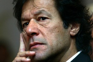Imran Khan is busy courting voters with the possibility of April elections. Photo / Bloomberg