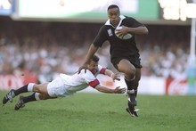 Jonah Lomu of New Zealand evades the diving tackle of Rob Andrew of England during the Rugby World Cup semifinal in at the Newlands Stadium in Cape Town. New Zealand won the match 45-29.
