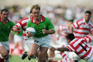 Mike Hall of Wales charges through against Japan. Photo / Getty Images