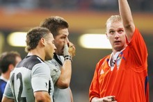 English referee Wayne Barnes sends Luke McAlister to the sin bin as Richie McCaw looks on. Photo / Getty Images