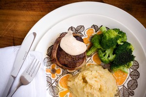 Bacon wrapped beef with olive oil mash, broccoli and bearnaise sauce. Photo / Babiche Martens