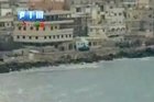 In this image taken from video made available August 14, 2011, by Shaam News Network (SHAMSNN), in which they purport to show armoured vehicles as they take up positions along the water front of Latakia, Syria. Photo / AP