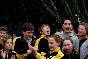 Pupils from Bombay Primary School have fun with the falling snow. Photo / Brett Phibbs