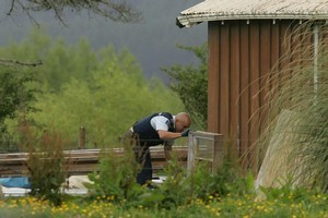 Police conducting a search as part of the raids in 2007. Photo / Alan Gibson