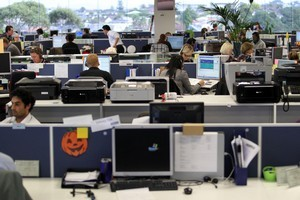 Staff at the Canon Oceania contact centre, working for Datacom, in Auckland. Photo / Janna Dixon