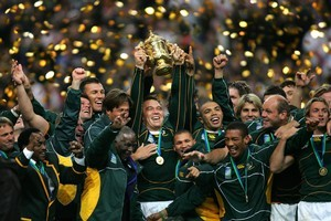 The Springboks celebrate their World Cup triumph over England in Paris with South African President Thabo Mbeki. Photo / Getty Images