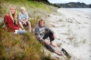Hannan, Morgan and Fraser Munroe on Onetangi Beach at Waiheke Island. Photo /  Greg Bowker