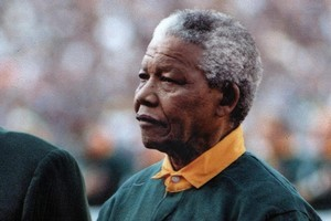 Nelson Mandela turned up at the game wearing Francois Pienaar's No 6 jersey. Photo / NZ Herald