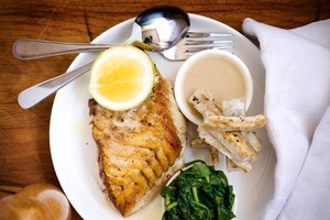 Roasted fish with taro, spinach and coconut sauce. Photo / Babiche Martens