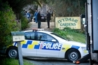 Police work at an address near Helensville where relatives discovered the body of 32-year-old Lee Ross McMurdo. Photo / Dean Purcell